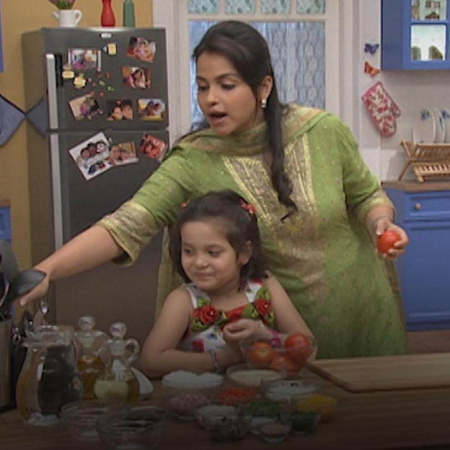 Meher helps her mother prepare Stuffed Tomatoes