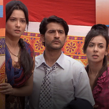 Teju, Rana and Mazhien follow Varsha to her village, where they also f
